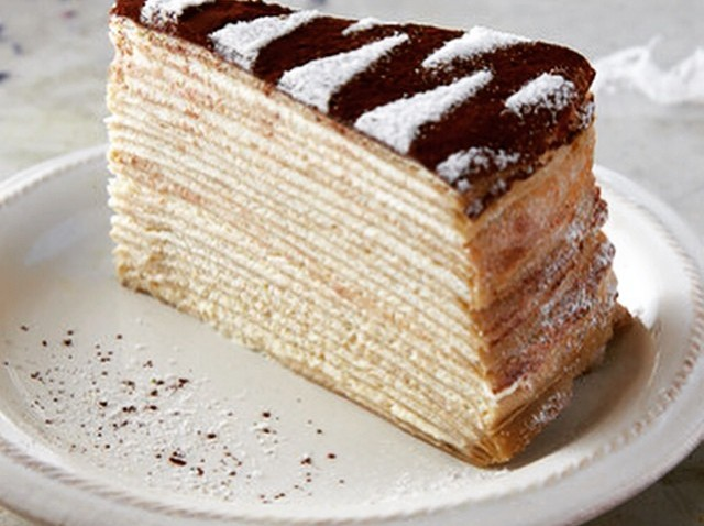 [nbcbayarea] Tiramisu Mille Crêpes So light that its 20 layers of crepe nearly melt in the mouth, this Gâteau Mille Crêpes-style tiramisu cake tastes richly of rum, espresso bean, cream and the dark cocoa powder it is dusted in. With soft, airy textu