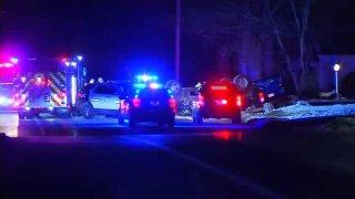 Police investigate the scene of a deadly crash on Sunday, Dec. 8, 2019 in Raynham, Massachusetts.