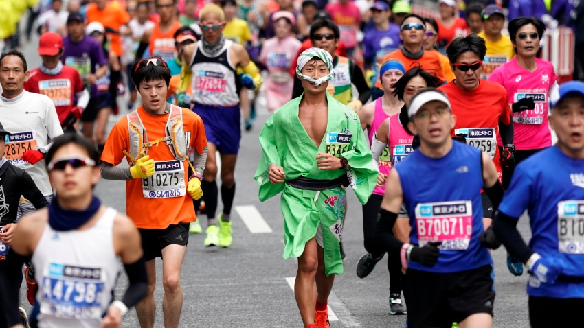 Runners in costumes make their way through Tokyo's Ginza shopping district at the Tokyo Marathon in Tokyo, Sunday, Feb. 25, 2018. About 36,000 people participated in the annual sport event. (AP Photo/Shizuo Kambayashi)