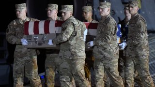 An Air Force carry team moves a transfer case containing the remains of Capt. Ryan S. Phaneuf, Thursday, Jan. 30, 2020, at Dover Air Force Base, Delaware. Phaneuf, 30, of Hudson, New Hampshire, died in a Bombardier E-11A aircraft crash in Ghazni province, Afghanistan, according to the Department of Defense.