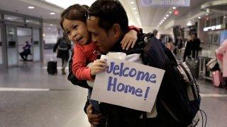 Thy Chea hugs his daughter