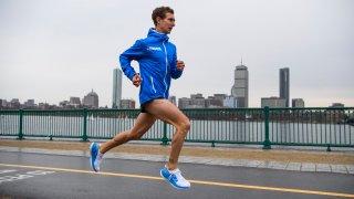 Tyler Andrews runs along the Charles River in Cambridge, Massachusetts, March 29, 2019.