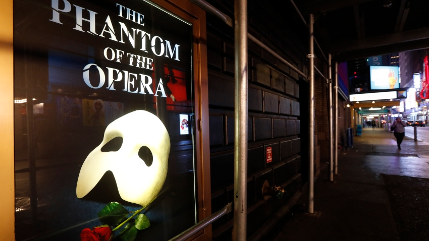 "A poster advertising ""The Phantom of the Opera"""