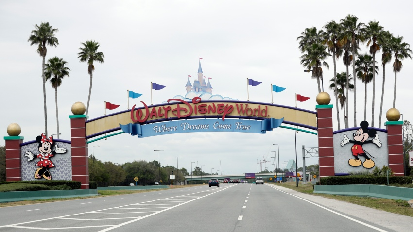 The road to the entrance of Walt Disney World has few cars Monday, March 16, 2020, in Lake Buena Vista, Fla.
