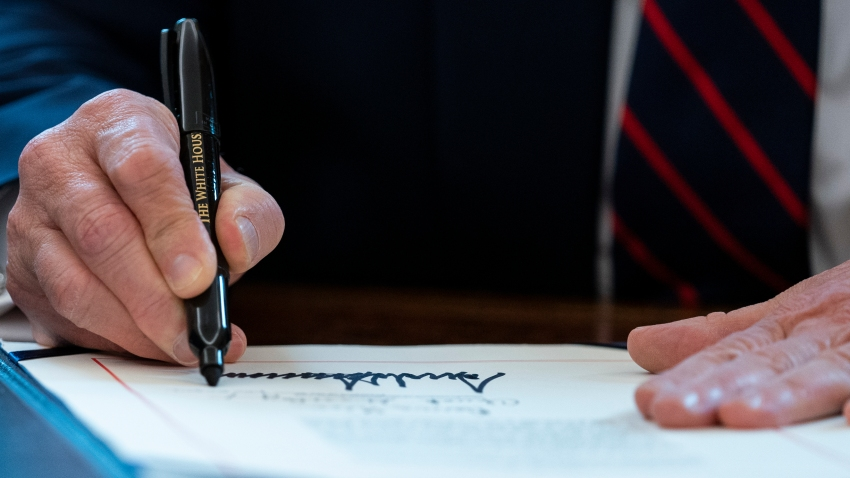 President Trump signs the CARES Act into law