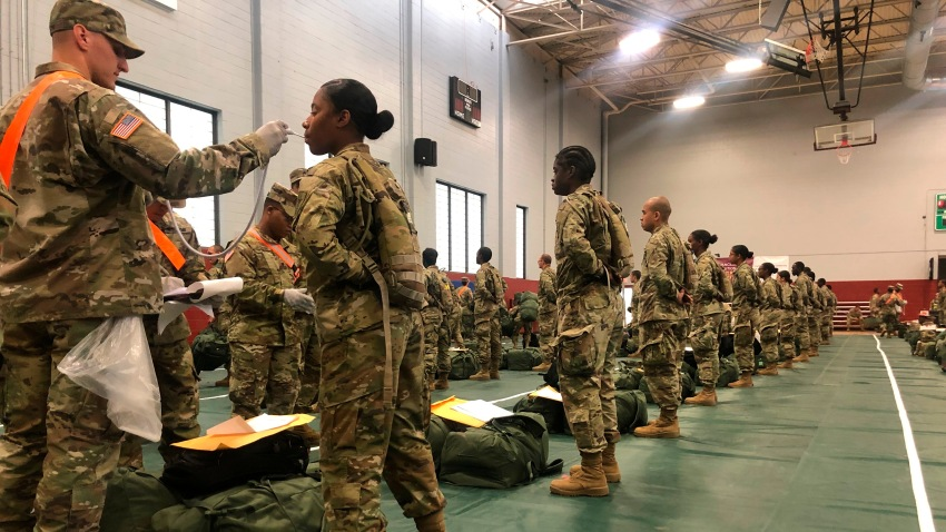 Army basic combat training graduates have their temperatures taken