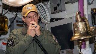 In this image provided by the U.S. Navy, Capt. Brett Crozier, then-commanding officer of the aircraft carrier USS Theodore Roosevelt (CVN 71), addresses the crew on Jan. 17, 2020, in San Diego.