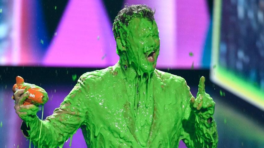 "Chris Pratt reacts after getting slimed as he accepts the award for favorite butt-kicker for ""Jurassic World: Fallen Kingdom"""