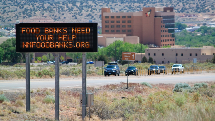 This May 7, 2020, image shows an electronic highway message board in Rio Rancho, New Mexico, that encourages people to donate to food banks.