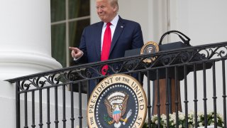 """President Donald Trump points during a """"Rolling to Remember Ceremony,"""" to honor the nation's veterans and POW/MIA, from the Blue Room Balcony of the White House, Friday, May 22, 2020, in Washington."""