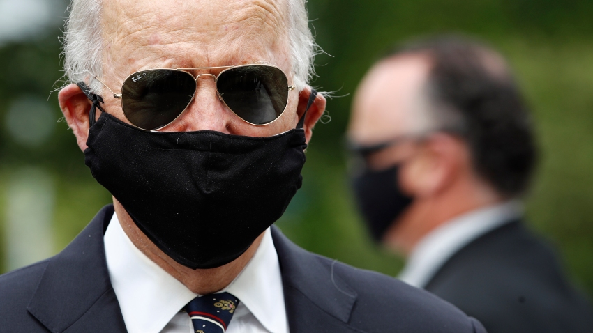 Democratic presidential candidate, former Vice President Joe Biden wears a face mask to protect against the spread of the new coronavirus as he and Jill Biden depart after placing a wreath at the Delaware Memorial Bridge Veterans Memorial Park, Monday, May 25, 2020, in New Castle, Del.