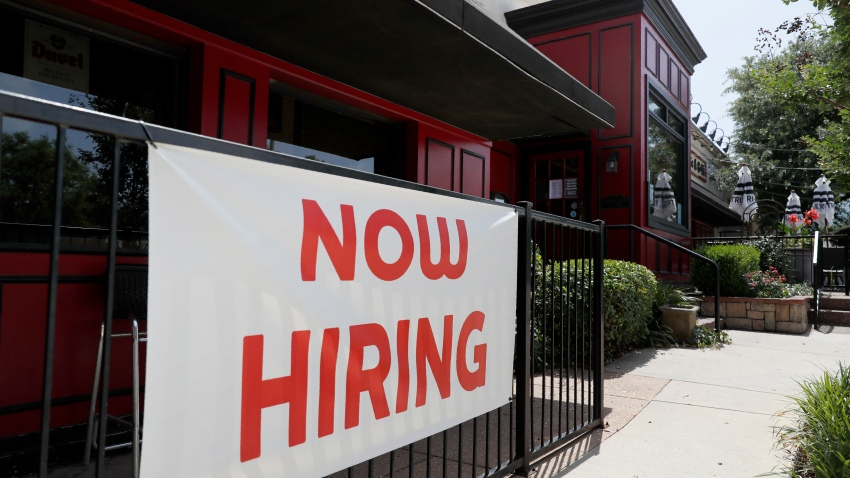 """Sherlock's, a pub in Addison, Texas, has a sign out front that reads, """"Now Hiring"""", Friday, June 26, 2020."""