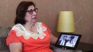 Laure Ghosn, whose husband Charbel Zogheib has been missing for the past 37 years, speaks as she holds their wedding portrait
