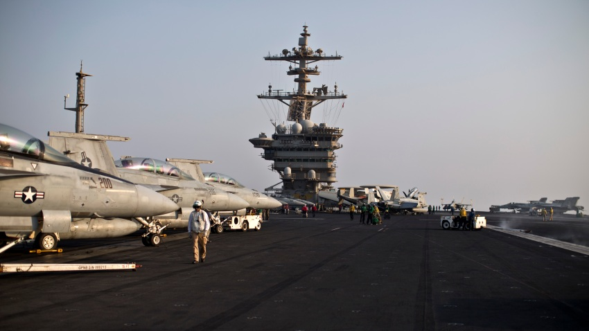 This photo shows a general view of the USS Theodore Roosevelt flight deck, Thursday, Sept. 10, 2015.