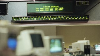A electronic message board on the floor of the Pacific Exchange displays the mandatory shut downs of Dow Jones Industrials, Monday, Oct. 27, 1997 in Los Angeles. The Dow Jones industrial average suffered its worst single-day point drop in history on Monday, plummeting more than 550 points before trading was automatically shut down for the rest of the day. A circuit breaker automatically halts trading on the New York Stock Exchange for half an hour when the Dow Jones Industrial Average drops by 350 points and again for an hour when the blue-chip indicator drops by 550 points. (AP Photo/Kevork Djansezian)