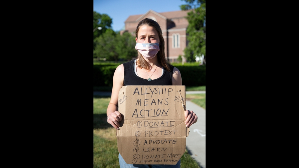 Laura Cowie-Haskell, from Roslindale, at a Black Lives Matter vigil in West Roxbury on Monday, June 8, 2020.