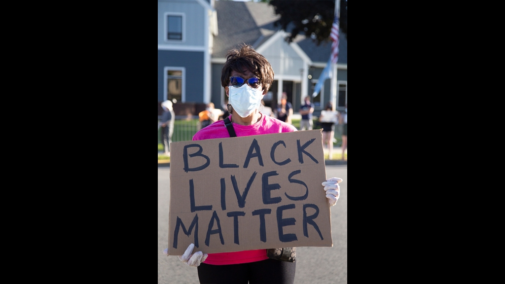 Georgia resident Gail Latimore, who is from Boston, at a Black Lives Matter vigil in West Roxbury on Monday, June 8, 2020.