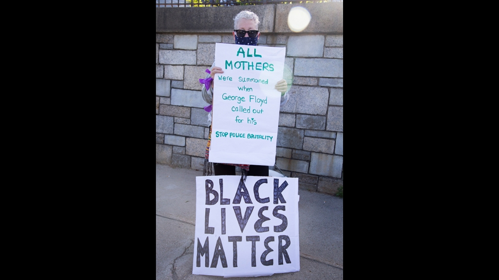 Renee Suchy from Hyde Park, Massachusetts,. at a Black Lives Matter vigil in West Roxbury on Monday, June 8, 2020.