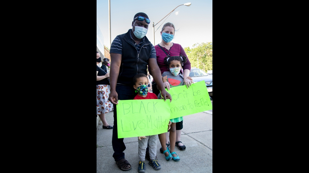 Aaron, Joy, Isaac and Elena Onyango from Boston's Mattapan neighborhood at a Black Lives Matter vigil in West Roxbury on Monday, June 8, 2020.