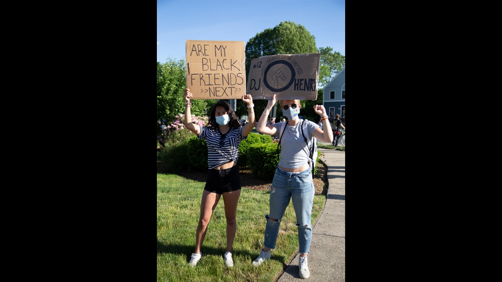 West Roxbury residents Clarissa Romero, a 25-year-old from Easton, Massachusetts, and Fanny Fellevik, a 26-year-old from Sweden, at a Black Lives Matter vigil in West Roxbury on Monday, June 8, 2020.
