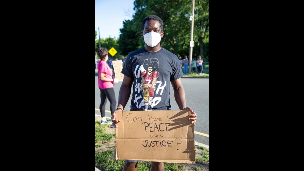 West Roxbury resident Pascale Opiyo, who is originally from Kenya, at a Black Lives Matter vigil in West Roxbury on Monday, June 8, 2020.