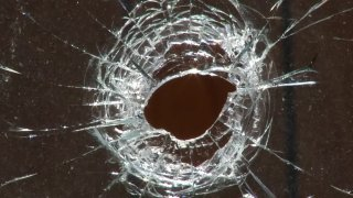 Bullet Hole in Glass Generic Shooting