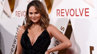 In this Nov. 2, 2017, file photo, honoree Chrissy Teigen poses at the 2017 Revolve Awards at the Dream Hollywood Hotel in Los Angeles.