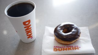 In this Jan. 30, 2020, file photo, a Dunkin' black coffee and chocolate frosted donut are photographed at a location in Mount Washington, Kentucky.