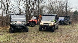 Cars arrive near the scene where 14 horses were shot dead in Floyd County, Kentucky, Dec. 19, 2019.