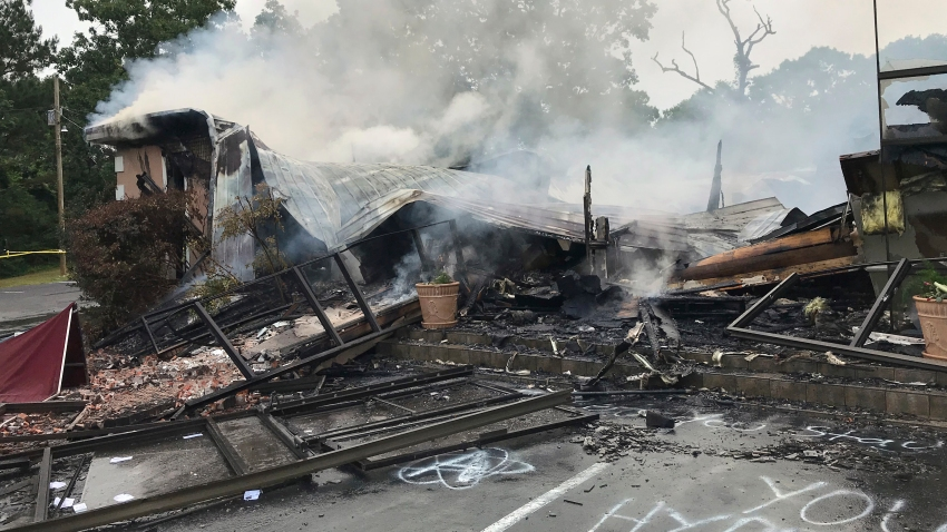 In this photo provided by the Marshall County Sheriff's Office, embers smolder on the remains of the First Pentecostal Church in Holly Springs, Miss., Wednesday, May 20, 2020.