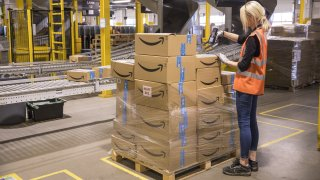 an employee checks packages at the Amazon fulfillment center