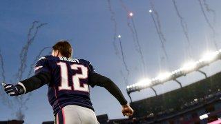 Tom Brady runs onto the field at Gillette Stadium