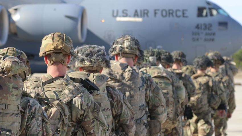 This Jan. 1, 2020, handout picture released by the U.S Army shows U.S. Army Paratroopers assigned to the 2nd Battalion, 504th Parachute Infantry Regiment, 1st Brigade Combat Team, 82nd Airborne Division, deploy from Pope Army Airfield, North Carolina on January 1, 2020.