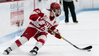 Sammy Davis of Boston University looks to pass during a game against the University of New Hampshire