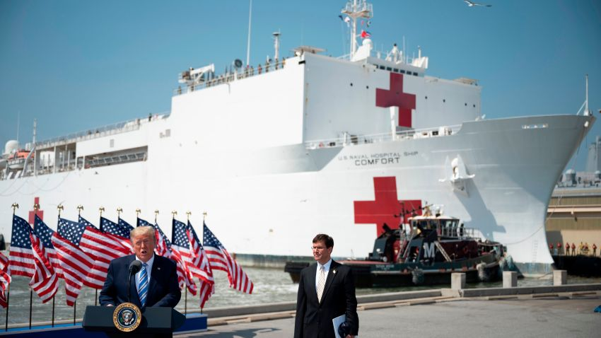 US President Donald Trump, with Defense Secretary Mark Esper in front of the USNS Comfort ship