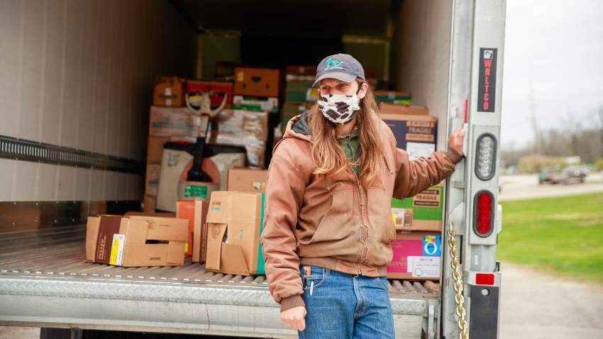 In this April 13, 2020, file photo, a driver from Hoosier Hills Food Bank delivers food at Pantry 279 to help those experiencing food insecurity during the COVID-19/coronavirus stay-at-home order. Hoosiers have been ordered to only travel for essential needs.