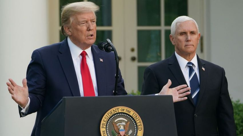President Donald Trump speaks as Vice President Mike Pence looks on during a news conference on the novel coronavirus, COVID-19, in the Rose Garden of the White House in Washington on April 27, 2020.