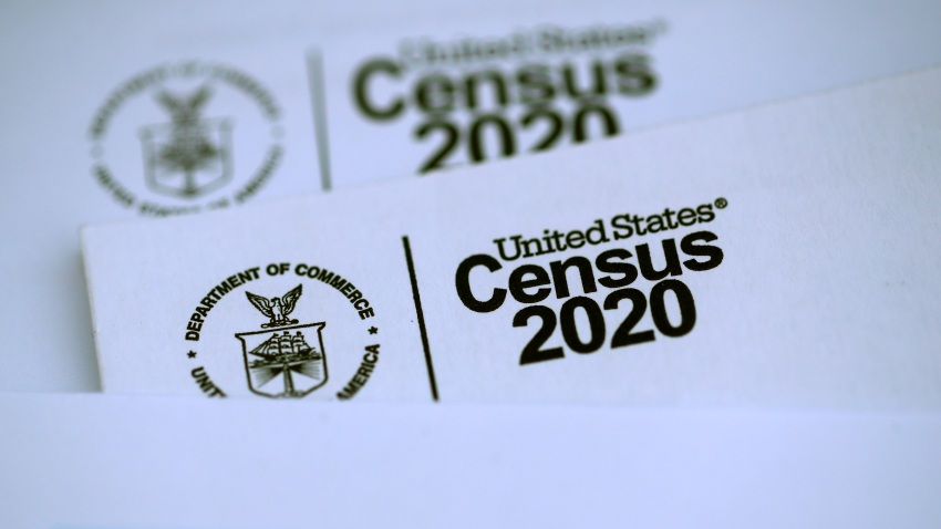 In this file photo, the U.S. Census logo appears on census materials received in the mail with an invitation to fill out census information online on March 19, 2020 in San Anselmo, California.