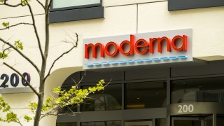 Signage is displayed on the Moderna Inc. headquarters in Cambridge, Massachusetts, U.S., on Monday, May 25, 2020.