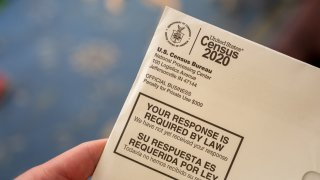 In this April 24, 2020, file photo, someone holds a letter from the Census Bureau regarding the 2020 Census in San Ramon, California.