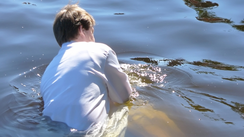 Pastor baptizing a person