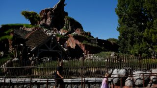 Guests walk in line to Splash Mountain at Walt Disney Co.'s Disneyland Park