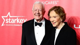 Former President Jimmy Carter (L) and former first lady Rosalynn Carter