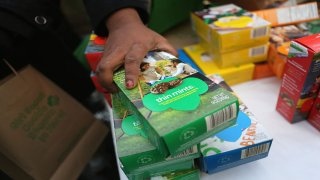 In this file photo, Girl Scouts sell cookies as a winter storm moves in on February 8, 2013 in New York City. The scouts did brisk business, setting up shop in locations around Midtown Manhattan on National Girl Scout Cookie Day.