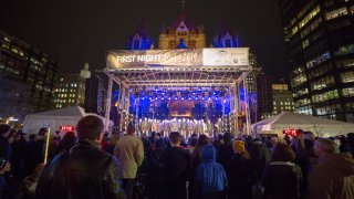 A crowd watches a performance at First Night Boston 2019