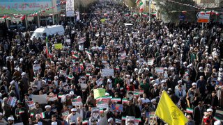 In this Jan. 3, 2017, file photo, Iranians take part during a state-organized rally against anti-government protests in the country, in Qom, Iran.