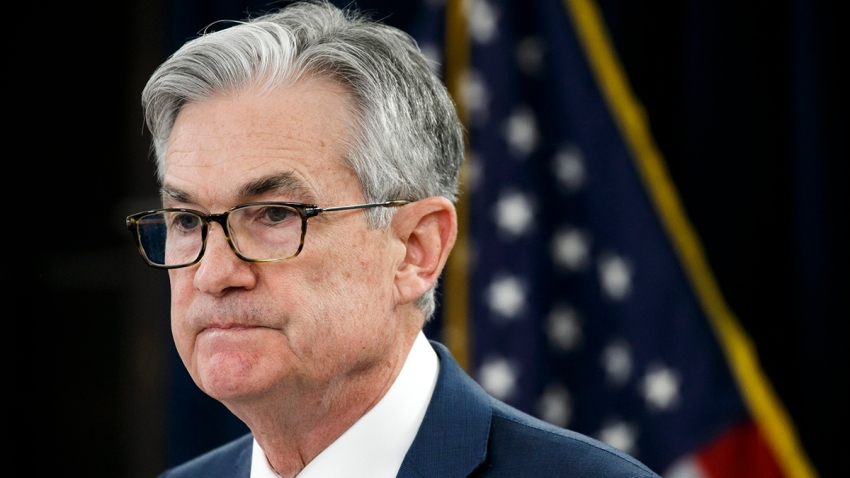 FILE - In this March 3, 2020, file photo, Federal Reserve Chair Jerome Powell pauses during a news conference to discuss an announcement from the Federal Open Market Committee, in Washington. In a series of sweeping steps, the U.S. Federal Reserve will lend to small and large businesses and local governments as well as extend its bond buying programs as part of the Fed's ongoing efforts to support the flow of credit through an economy ravaged by the COVID-19 outbreak.
