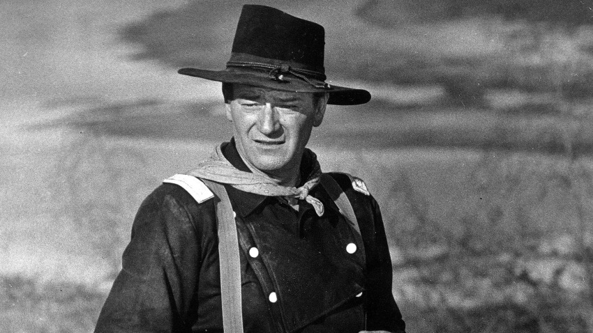"""In this undated photo, John Wayne appears during the filming of """"The Horse Soldiers."""" In the latest move to change place names in light of U.S. racial history, leaders of Orange County's Democratic Party are pushing to drop film legend Wayne's name, statue and other likenesses from the county's airport because of his racist and bigoted comments."""
