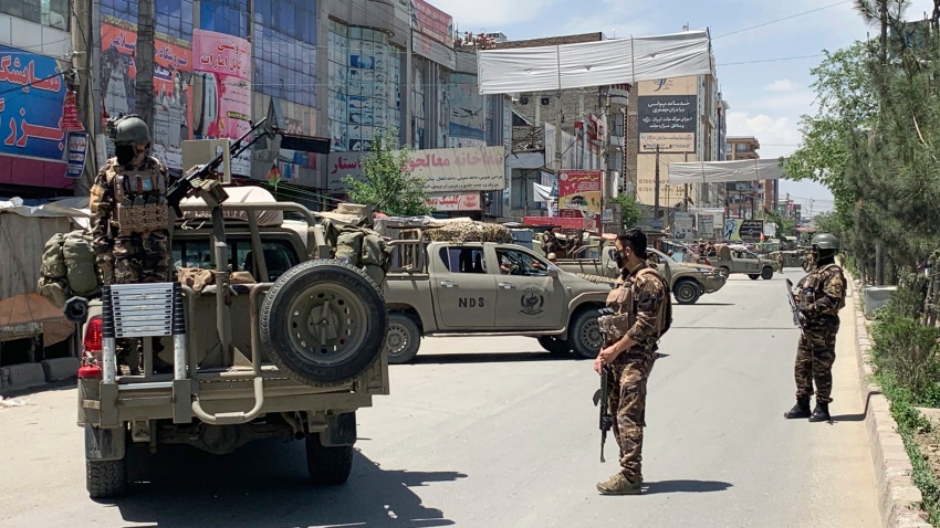 Afghan security personnel arrive at the site where gunmen attacked in Kabul, Afghanistan, Tuesday, May 12, 2020.