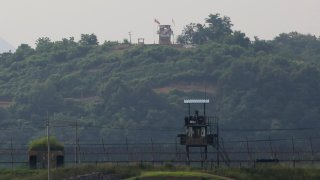 Military guard posts of North Korea, rear, and South Korea, foreground, are seen in Paju, at the border with North Korea, South Korea, Tuesday, June 16, 2020.